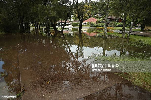 A footpath next to Narrabeen Lake is submerged on April 22 2015 in Sydney Australia Three people have died and more than 200000 are still without...
