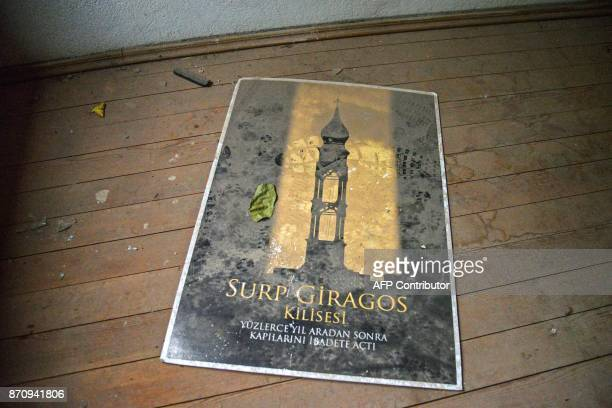 A footprint across a flyer that reads After hundreds of years Surp Giragos church opens its door again for praying lies on the floor of the Surp...