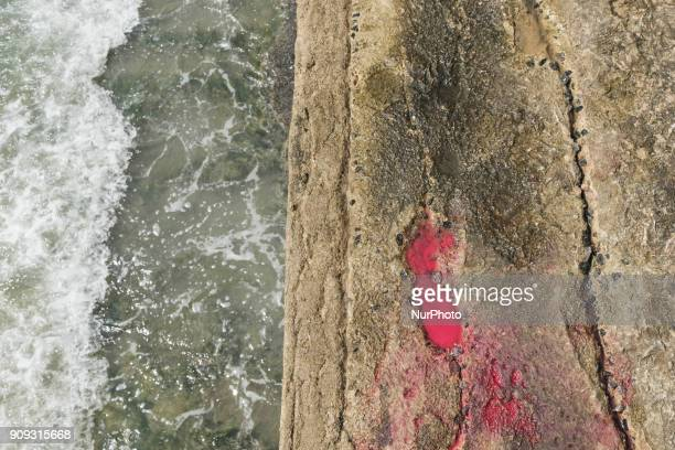 A footprint with blood is seen on the sea retaining wall near the accident site in Recife Northeast Brazil on January 23 2018 A helicopter from the...