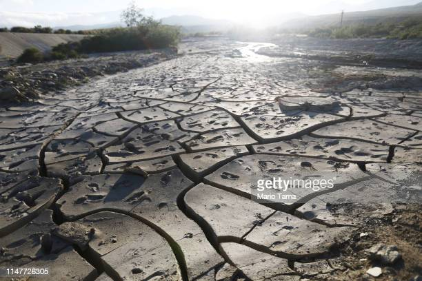 Footprints are marked on a dried section of creekbed along Mission Creek following heavy winter runoff in the Coachella Valley on May 7 2019 in...