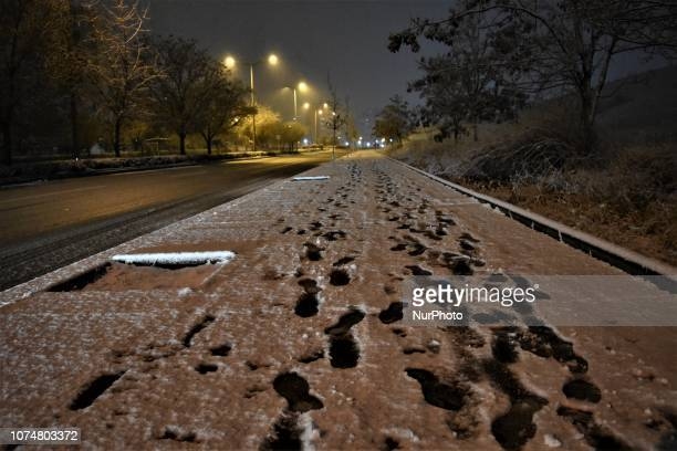 Footprints are seen on a snowcovered sidewalk during a heavy snowfall in the winter season in Ankara Turkey on December 25 2018
