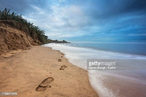 footprints at shore of beach - lincolnshire stock pictures, royalty-free photos & images