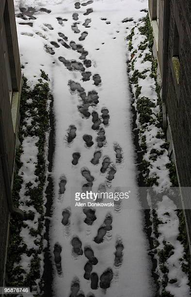 Footprints In A Snow Covered Pathway