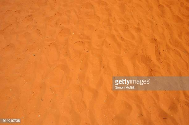 Footprints in red sand