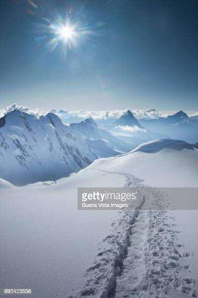 footprints in the snow - european alps stock pictures, royalty-free photos & images