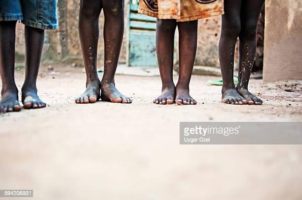 foots of african children - ワガドゥグ ストックフォトと画像