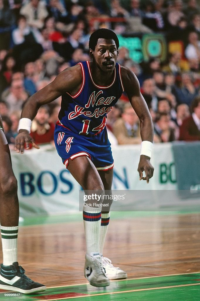 Foots Walker #14 of the Phoenix Suns battles for position against the Boston Celtics during a game played in 1983 at the Boston Garden in Boston, Massachusetts.