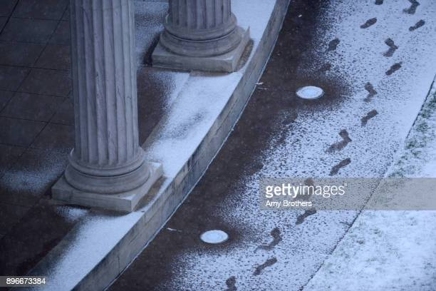 Footsteps in the snow at Civic Center Park An arctic blast brings snow and cold temps to Denver metro area on December 21 2017 in Denver Colorado