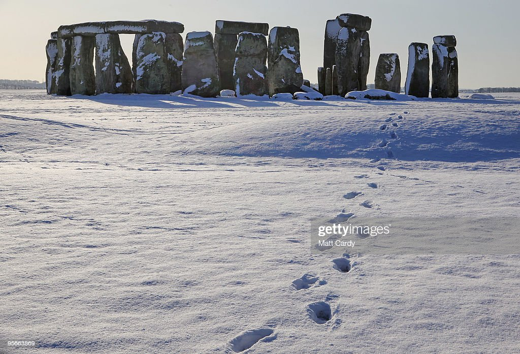 Footsteps in the snow lead from the historic monument of Stonehenge on January 9 2010, in Wiltshire, England. The UNESCO world heritage site and one the UK's most popular tourist destinations has been closed due to the ice and snow on the approach paths and footways. Britain is continuing to be gripped by the Arctic weather and forecasters are predicting more snow in the next 24hrs and that the cold spell could last for at least another week.