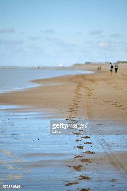 Footsteps on the beach.