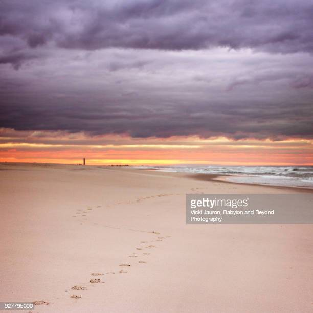 Footsteps Toward Sunrise Under Clouds