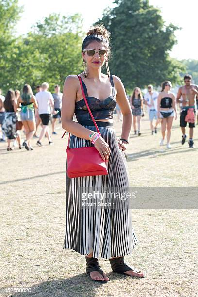 Footwear buyer Simren Ahir wearing a Celine bag, H and M skirt and top, Ray Ban sunglasses and Ash sandals at Lovebox 2014 on July 18, 2014 in...
