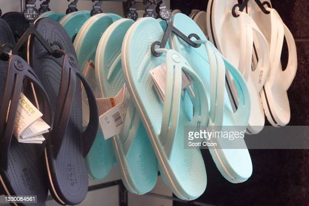 Footwear is offered for sale at a Crocs retail store on July 22, 2021 in Chicago, Illinois. Crocs Inc. Today reported second-quarter net income of...