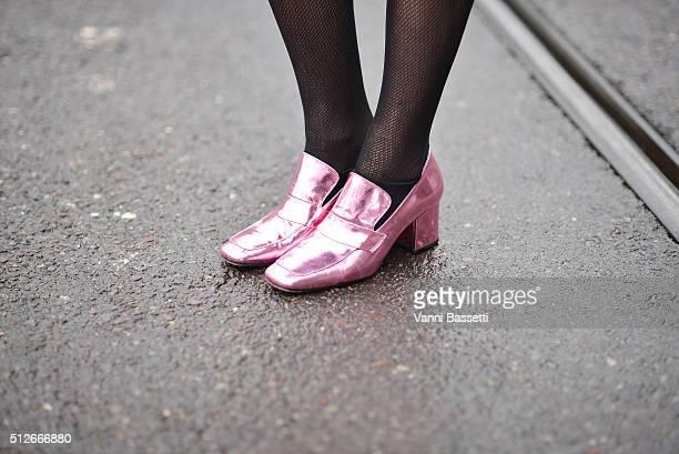 Footwear News's Fashion director Mosha Lundstrom Halbert poses wearing Dorateymur shoes before the Jil Sander show during the Milan Fashion Week...
