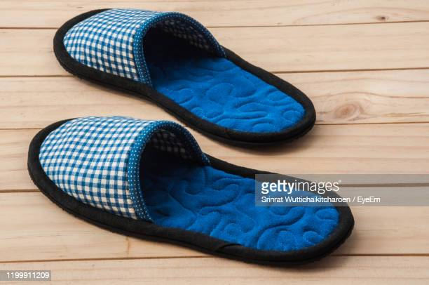 footwear on hardwood floor - flip flop stock pictures, royalty-free photos & images