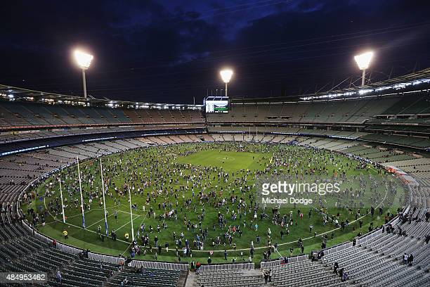 Footy fans enjoy kick to kick on the hallowed turf after the round 21 AFL match between the Carlton Blues and the Melbourne Demons at Melbourne...