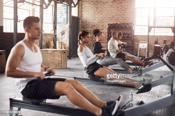 for a full body workout try the rowing machine - physical education stock pictures, royalty-free photos & images