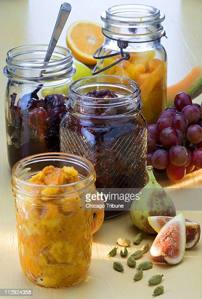 For a little summer in a jar try making these preserves including clockwise from top apricot chutney quince and currant preserves with saffron fig...