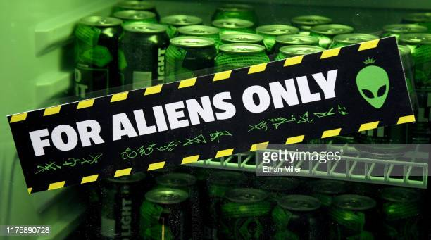 """For Aliens Only"""" sticker adorns a refrigerator for beer at the Area 51 Celebration at the Downtown Las Vegas Events Center on September 19, 2019 in..."""