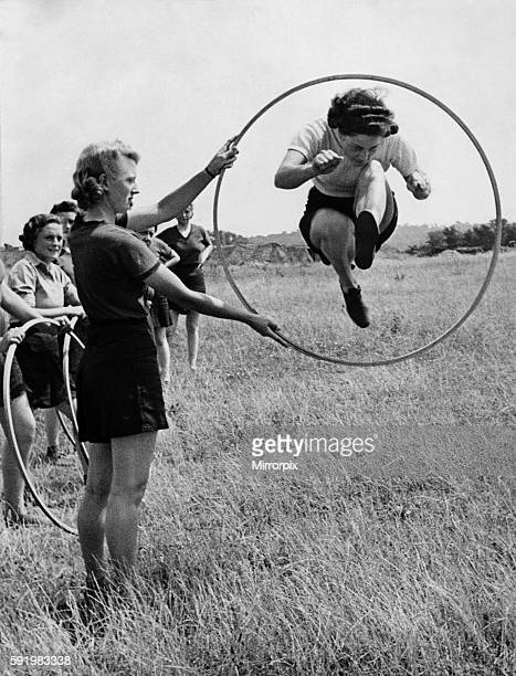 PT for ATS girls Instructor showing the girls how to jump through the Loop Scene at a mixed AA Battery in the London area August 1943 P000254
