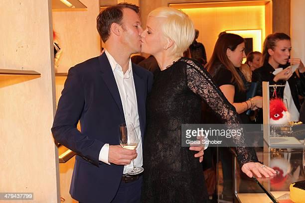 FENDI for Barbara Sturm and Adam Waldman kiss at FENDI boutique opening on March 18 2014 in Munich Germany