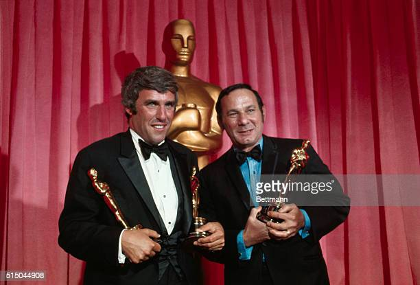 """For """"Best Song in a Movie"""" for 1969, composer Burt Bacharach and lyricist Hal David hold Oscars they won for """"Raindrops Keep Falling on my Head"""" from..."""