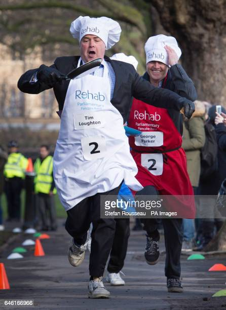 MP for East Worthing and Shoreham Tim Loughton and journalist George Parker take part in the annual Rehab Parliamentary Pancake Race in which MPs...