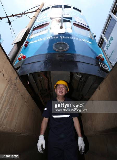 For Hong Kong Tramways 110th anniversary backpage Senior mechanical foreman Tang Paklam inspects a tram maintained at Hong Kong Tramways Whitty...