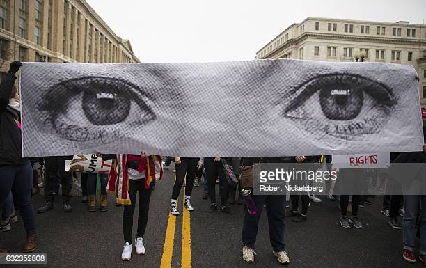 For marchers attending the Women's March on Washington hold up a photograph from the French art project 'Inside Out' by artist JR on January 21 2017...