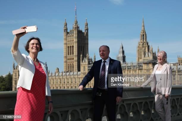 MP for North Devon Selaine Saxby MP for Dudley Marco Longhi and MP for Bishop Auckland Dehenna Davison take a selfie in front of Parliament while...