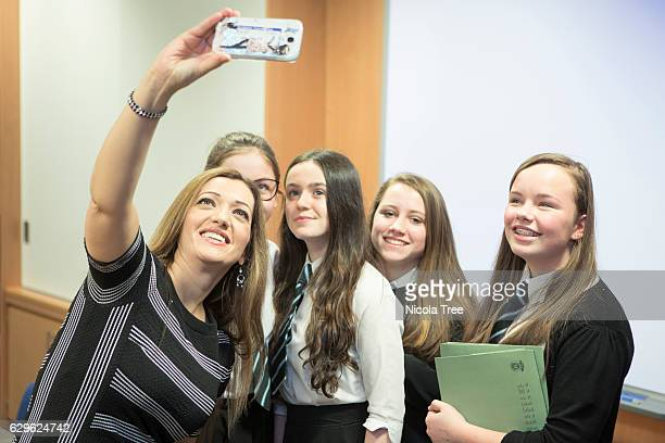 MP for Ochil and South Perthshire Tasmina AhmedSheikh takes selfie photographs with students as she visits Crieff High School in her constituency on...