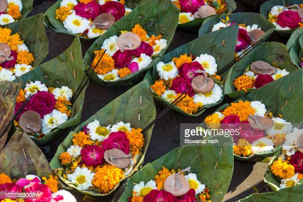for religious offerings, basket of flowers with diyas (indian lamp), haridwar, uttarakhand, india - haridwar stock pictures, royalty-free photos & images