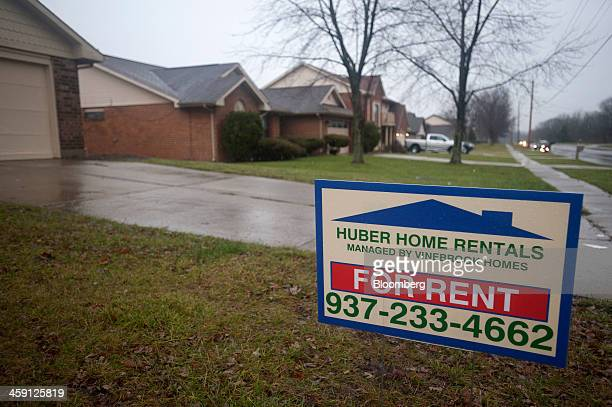 A For Rent sign by Huber Home Rentals managed by Vinebrook Homes sits in the front yard of a rental property in Huber Heights Ohio US on Saturday Dec...