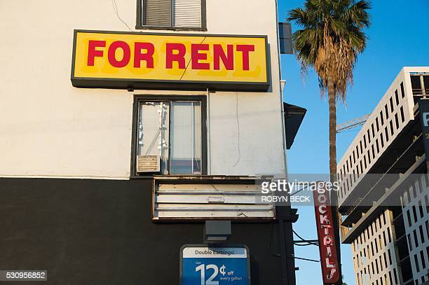 A For Rent sign is seen on a building Hollywood California May 11 2016 Angelinos are feeling the increasing burden of rising rents and threats of...