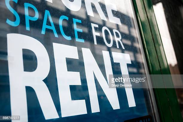 For Rent sign on store window