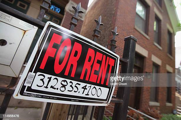 A 'For Rent' sign stands in front of a house on May 31 2011 in Chicago Illinois According to the Standard Poor's CaseShiller Home Price Index home...