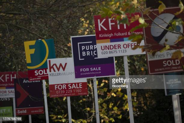 For sale and sold signs for estate agents outside residential flats in the Balham district of London, U.K., on Tuesday, Nov. 24, 2020. Asking prices...