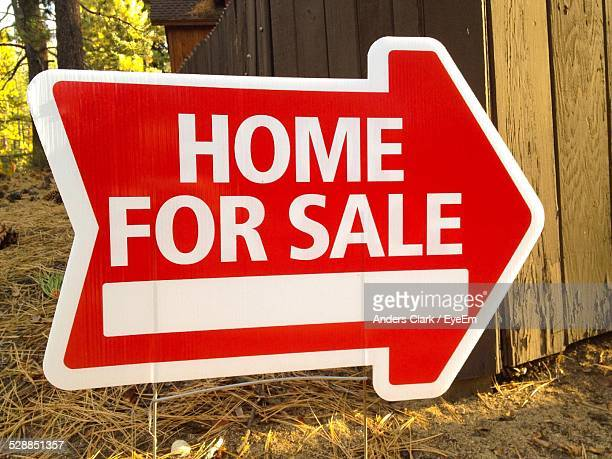 For Sale Arrow Sign On Ground