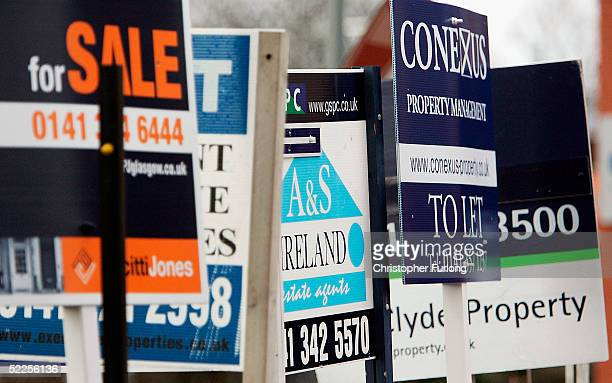 For Sale boards advertise property for sale on February 28 2005 in Glasgow Scotland The Liberal Democrats have unveiled their plans for the economy...