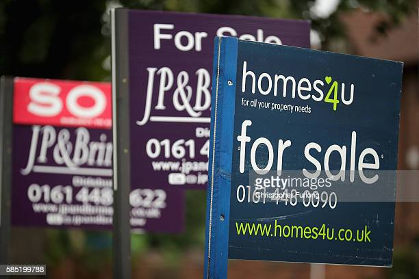For Sale boards stand outside homes in Didsbury on August 2 2016 in Manchester England Home ownership acroos the country has seen a sharp drop across...