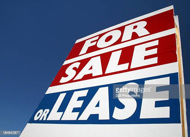 For Sale Or Lease Sign Sitting Under The Blue Sky
