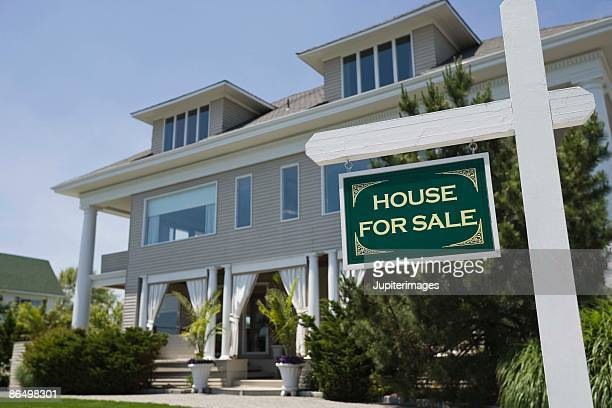 For sale sign by house exterior