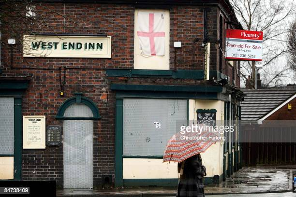 A for sale sign hangs from the side of a rundown pub on February 11 2009 in StokeonTrent England Official Government figures released today show that...