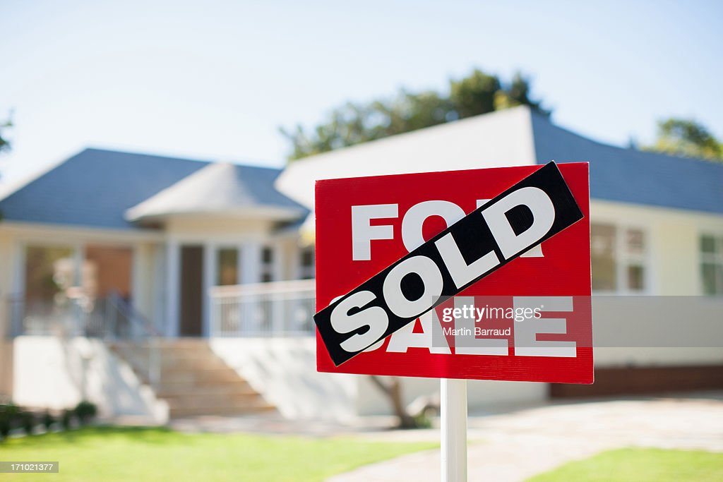For sale sign in yard of house : Stock Photo