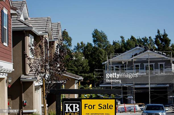 "For Sale"" sign is displayed near houses under construction at the KB Home's Whisler Ridge housing community in Lake Forest, California, U.S., on..."
