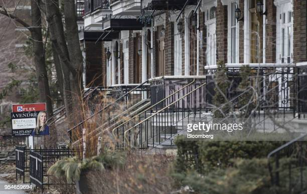 A 'For Sale' sign is displayed outside a home in the Le Plateau MontRoyal borough of Montreal Quebec Canada on Saturday April 14 2018 An economic...