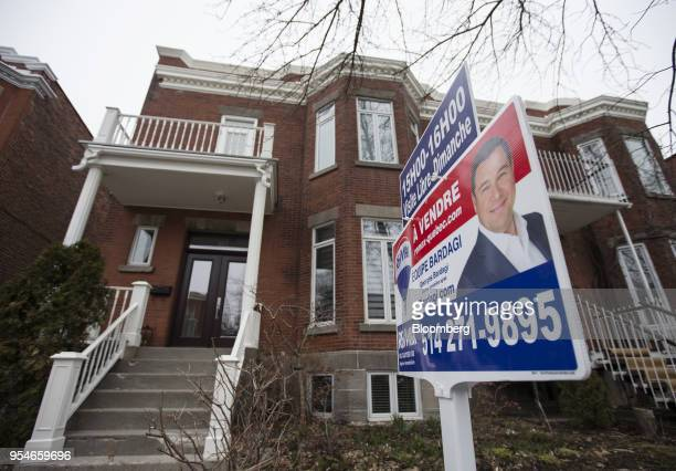 A 'For Sale' sign is displayed outside a home in the Outremont borough of Montreal Quebec Canada on Saturday April 14 2018 An economic revival in...