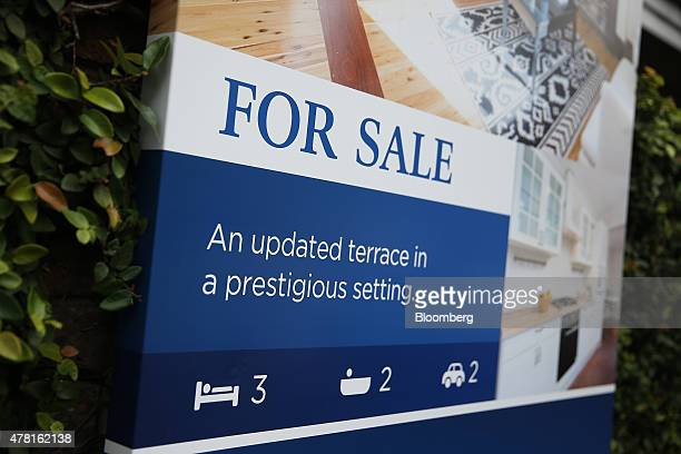 A 'For Sale' sign is displayed outside a terrace house in the suburb of Woollahra in Sydney Australia on Thursday June 18 2015 Surging home prices in...