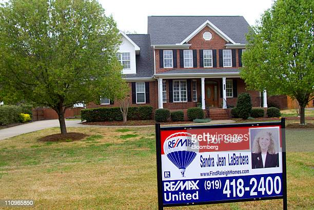 A for sale sign is displayed outside of a home in Clayton North Carolina US on Monday March 28 2011 A gain in the number of Americans signing...