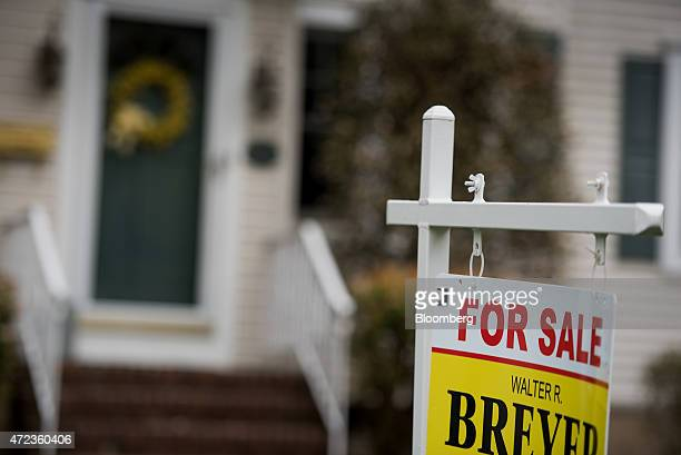 A 'For Sale' sign is displayed outside of a house in Oradell New Jersey US on Friday May 1 2015 The number of Americans who signed contracts in March...